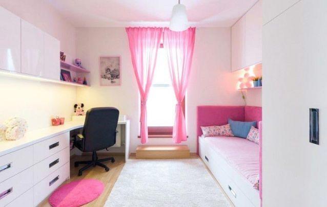 Quarto planejado minimalista, com leves toques de rosa