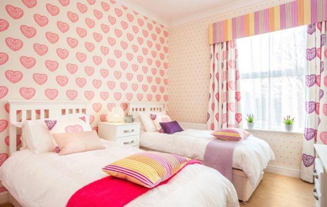 Um delicado quarto de meninas para irmãs que gostam de um pouco de romantismo