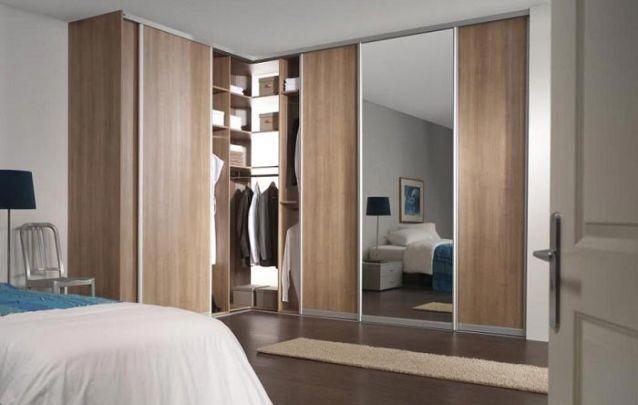 """Um guarda roupa planejado em """"L"""" é ótimo para otimizar espaço, assim é possível utilizar duas paredes do cômodo para esta função"""