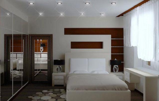 O guarda roupa embutido com portas de espelho praticamente duplica o tamanho do quarto