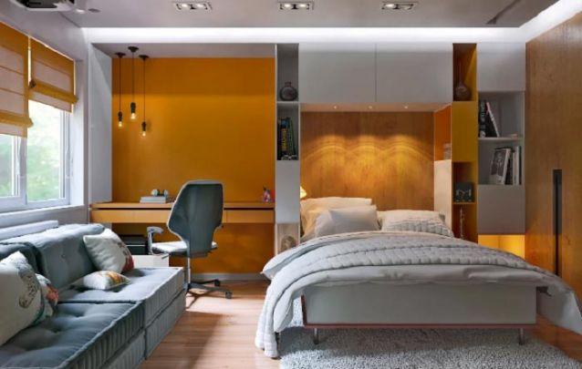 Aqui o armário para quarto foi pensado de modo a ocupar o espaço vertical atrás da cama