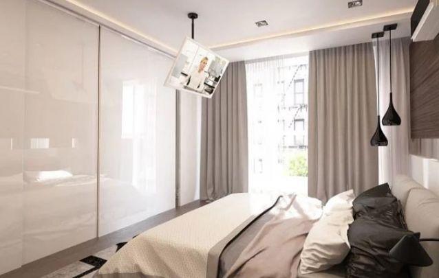 O guarda roupa planejado branco auxilia na amplitude do quarto pequeno