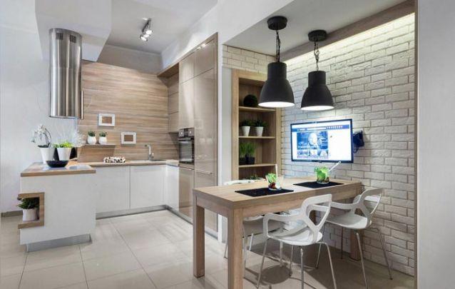 A mistura de materiais e acabamentos dos móveis planejados deixam o design atual