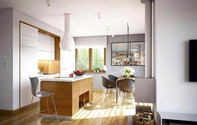 Móveis planejados foram escolhidos para produzir esta cozinha integrada com a sala de jantar