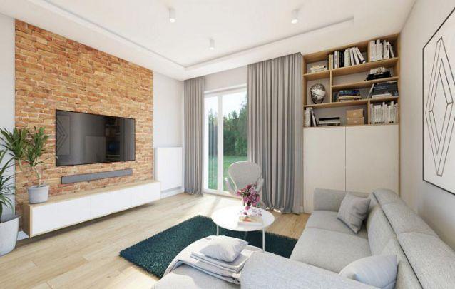 Aposte em uma parede sem utilidade para acomodar um armário planejado e aumentar o armazenamento da sala de estar