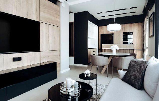 Móveis planejados criam um design sóbrio e refinado para estes ambientes conjugados