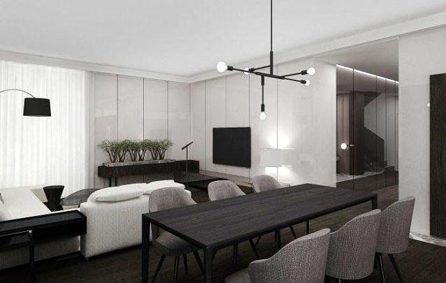 O painel planejado cobre as paredes da sala de estar