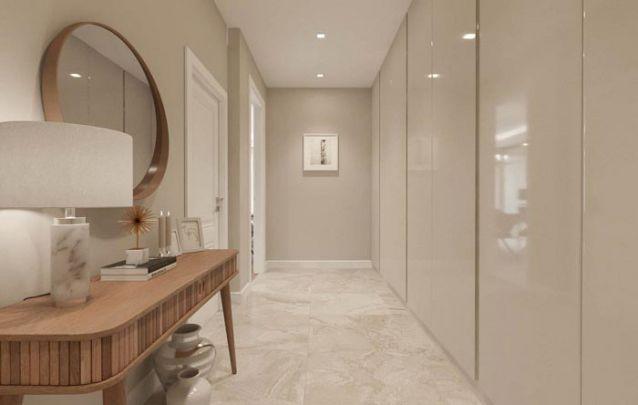 Aproveite um corredor sem utilidade para incluir móveis planejados e aumentar a área de armazenamento no apartamento