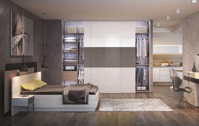 Em um loft, o guarda roupa planejado pode ser utilizado para fazer a separação de ambientes