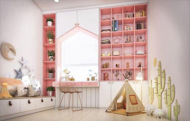 O armário planejado infantil conta com nichos, portas e uma escrivaninha embutida