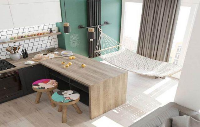 Cozinha americana integrada com uma área para descanso