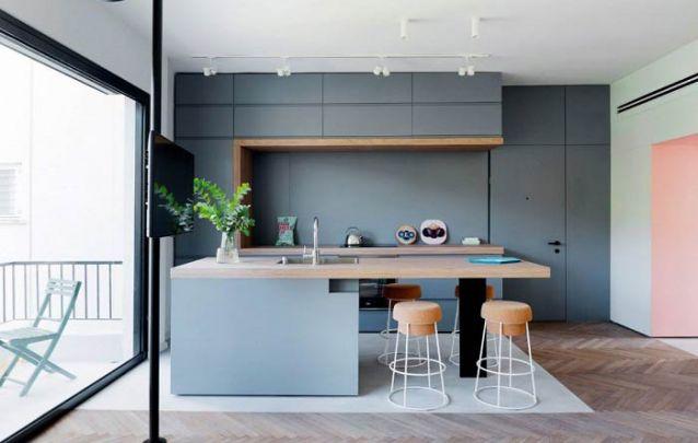 O cinza em todos os seus tons é uma opção moderna para compor a sua cozinha americana