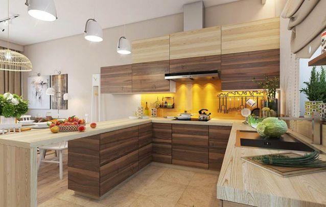 A parede amarela é o toque vibrante que faltava nesta cozinha americana