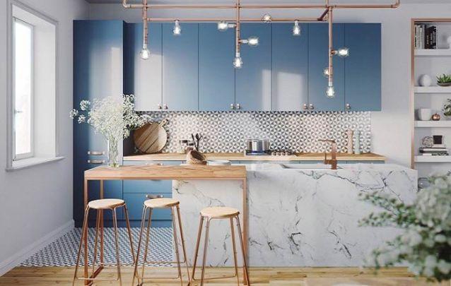 A cor azul e os acabamentos em cobre conferem jovialidade para esta cozinha americana