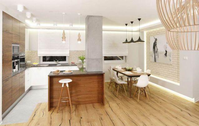 O piso cimentício delimita a área da cozinha americana