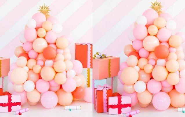Que tal um pinheiro de natal feito com balões para inovar?