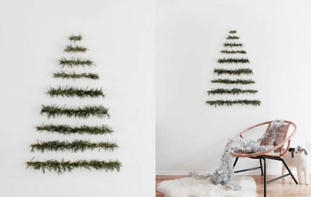 Alguns galhos na parede criam um pinheiro de natal alternativo e minimalista