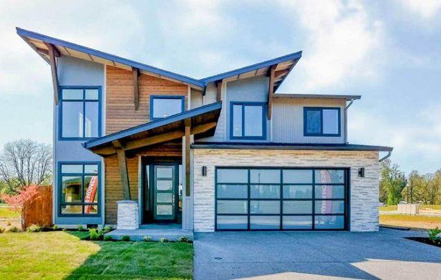 Uma opção de casa moderna com dois andares e garagem
