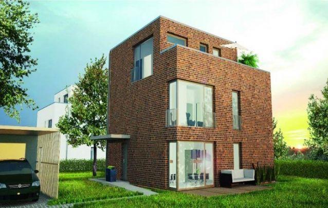 Que tal esta casa moderna de três andares feita com tijolos aparentes?