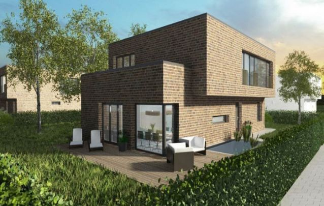 Uma casa moderna feita de tijolos aparentes trazem características do atual estilo industrial