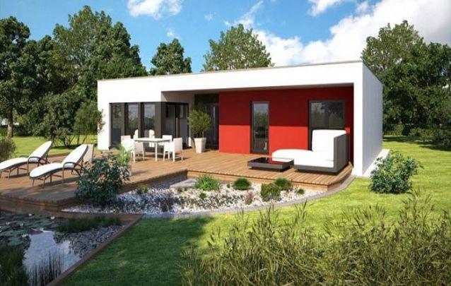 A parede vermelha vem para quebrar a paleta de cores neutras desta pequena casa moderna