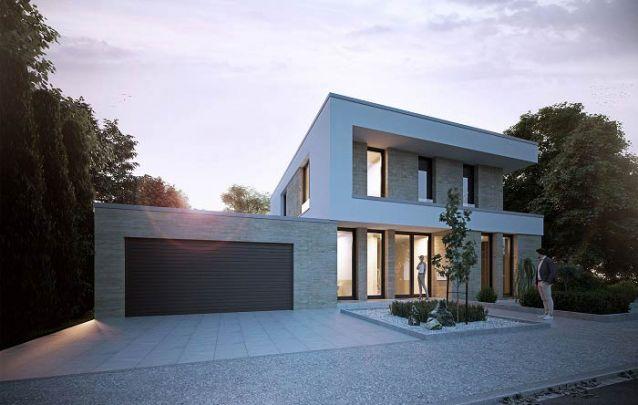Revestimentos distintos criam um contraste interessante na fachada desta casa moderna