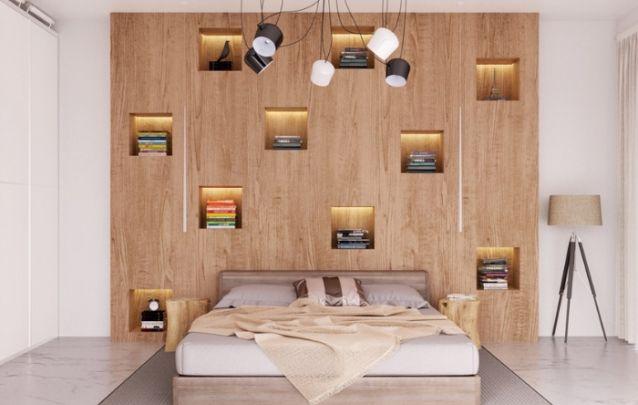 Aqui o destaque da decoração é a estante de nichos atrás da cama, a qual é moderna e funcional