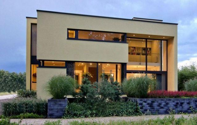 Projeto de casa com dois andares e uma fachada encantadora