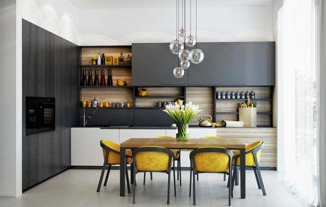 Nesta cozinha em L optaram por acomodar também a mesa de jantar