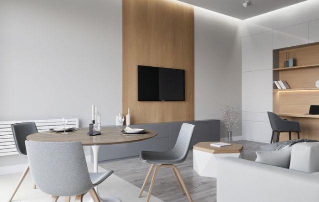 Um modelo de painel de tv no sentido vertical, que segue da parte mais baixa até o  seu teto, faz o pé direito parecer um tanto quanto mais alto do que realmente é. E por esse motivo o painel ganha um belo glamur.