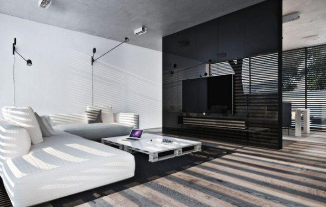 O painel para tv preto que vai do chão ao teto é um projeto imponente, que traz singularidade ao ambiente. Quando a televisão não está em uso, é praticamente imperceptível.