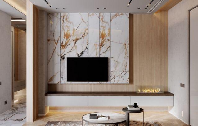 Se você busca por luxo, esta é uma ótima opção dentre os modelos de painel existentes. O efeito de mármore e a lareira a etanol na lateral, criam um visual contemporâneo e requintado na sala de estar.