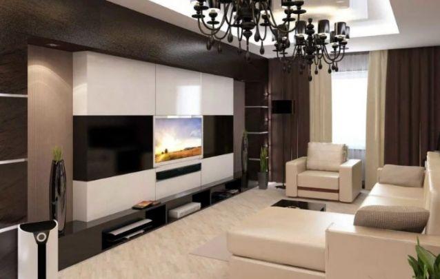 O painel avançado aparece bem centralizado na moldura que contorna toda a parede, isto faz com que o mesmo se destaque significadamente, e evidencie com elegância o aparelho de tv.