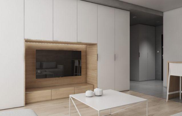 Painel de tv embutido em um armário, é uma ótima alternativa para otimizar o espaço disponível. E para trazer destaque ao eletrônico, o ideal é optar por uma cor diferente para o nicho.