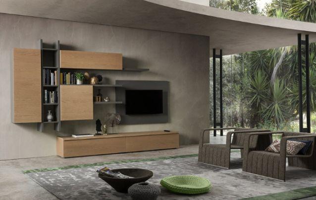 O cinza é uma cor atual, e quando aliado a tons amadeirados, deixa o ambiente contemporâneo. O painel simples é complementado pela estrutura assimétrica para armazenamento fixa ao lado.