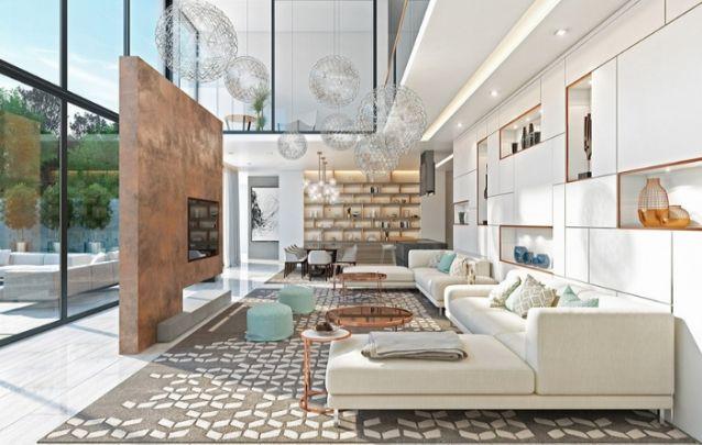 Modelos de painel desprendidos de paredes, são ótimos para facilitar a circulação no cômodo, principalmente em ambientes integrados. O painel escolhido segue um acabamento com nuances em cobre, para harmonizar com o restante da decoração.