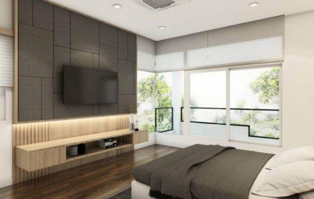 Painel estofado não é exclusividade para cabeceiras de cama, ele também pode ser utilizado como apoio para a televisão. Uma peça com este acabamento se torna singular e moderna