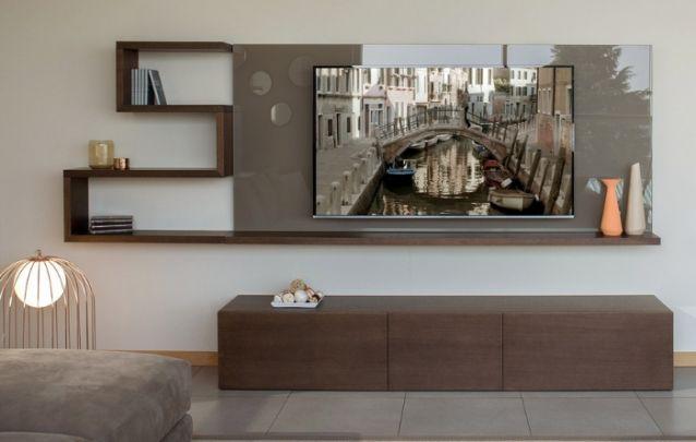 O diferencial deste painel é a prateleira escultural que o contorna. A sobreposição de tons é elegante e atual. Que também auxiliam na organização da sua sala de estar, deixando cada objeto em seu devido lugar.