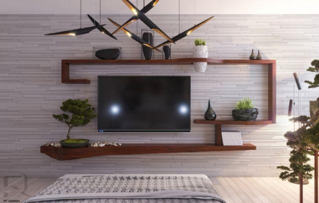 Nesta sala de estar a televisão foi fixa diretamente na parede, dispensando a necessidade de um painel para tv, mas para o decor não ficar sem graça, foram adicionadas algumas prateleiras, as quais criam uma espécie de moldura para o eletrônico.