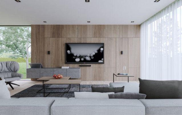 Para criar um ambiente decorado e muito bem equilibrado, as mesas de centro foram escolhidas para combinar com a tonalidade do painel. O mesmo trás modernidade a sala.